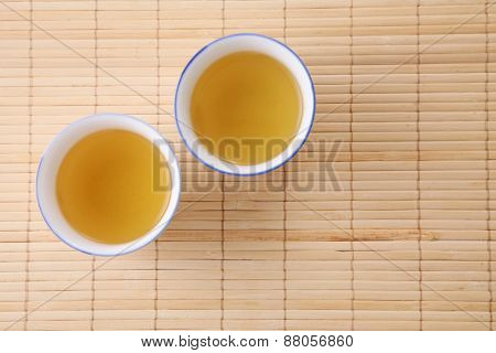 Japanese white tea pot on the bamboo mat