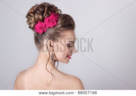 fashion portrait of beautiful attractive girl with a gentle elegant evening wedding hairstyles high
