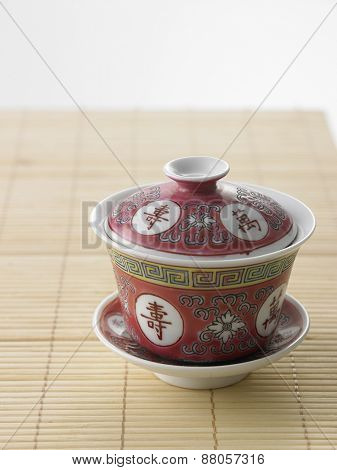 chinese tea cup on the bamboo mat