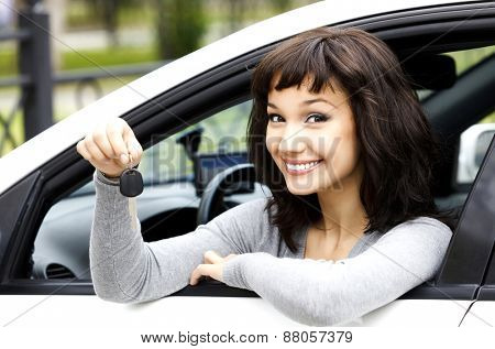Pretty girl showing the car key