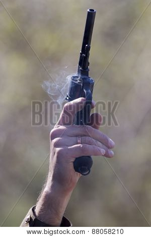 revolver in hand immediately after the shot