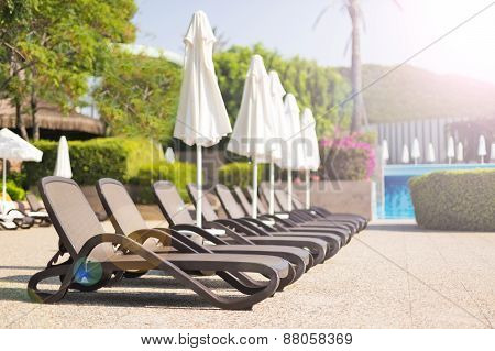 Sunbeds Near A Pool