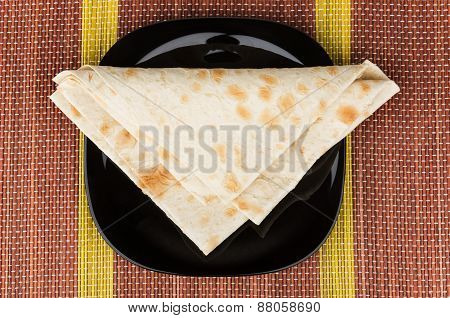 Folded Triangle Of Thin Armenian Lavash In Black Plate On Mat