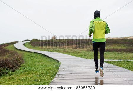 Runner Man Running In A Rainy Day