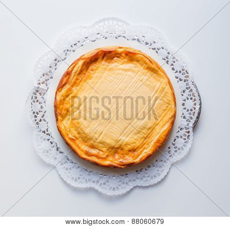 Cheesecake On A White Background With Cake Lace
