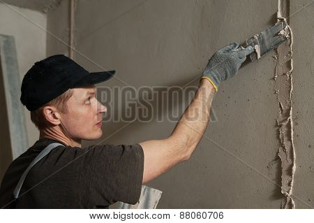 Worker Gets Plaster On The Wall
