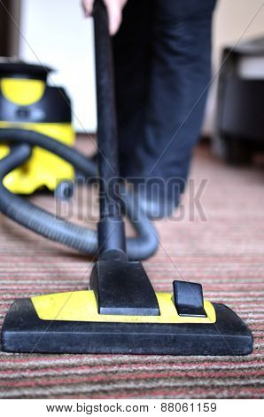 Maid cleaning the carpet