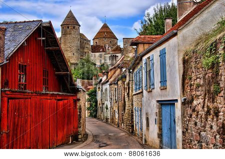 Beautiful Burgundy street with ancient towers, France