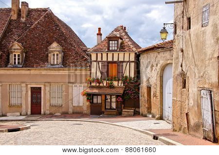 Timbered house on a quaint street in Burgundy, France