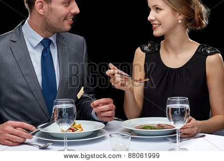 restaurant, food, people, date and holiday concept - close up of happy couple talking at restaurant