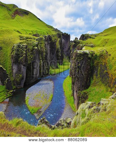 Fantastic country Iceland. The most picturesque canyon Fjadrargljufur and river flowing along the bottom of the canyon