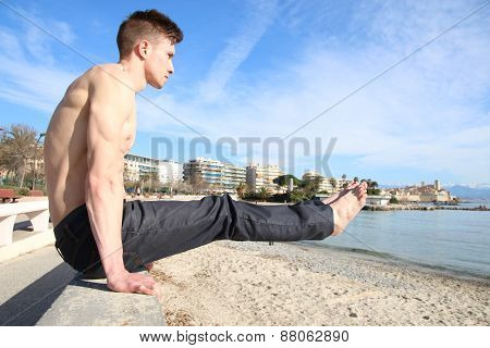 man holding in equilibrium on a wall