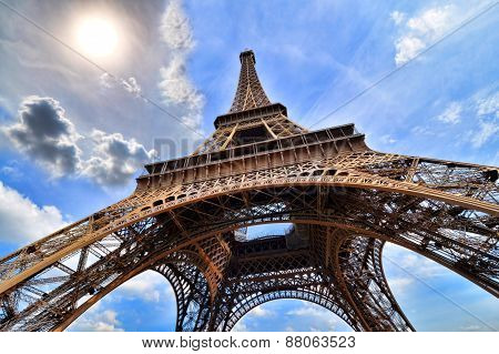 Eiffel Tower upward view with sun, Paris