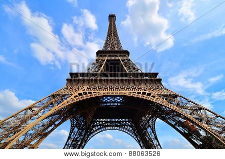 Eiffel Tower upward view under blue skies, Paris, France