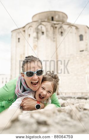 Caucasian Mother And Daughter Hugging, Smiling