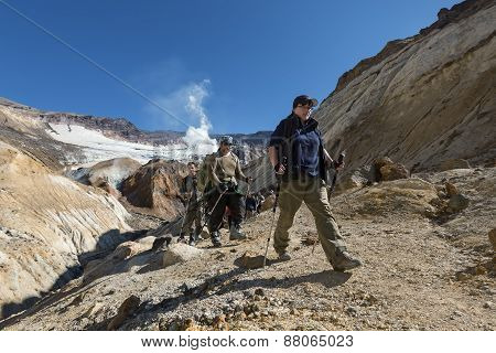 Group Of Tourists Climbing The Canyon In Crater Mutnovsky Volcano. Kamchatka