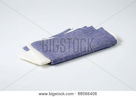 blue and white napkins on white background