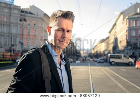 Manager walking down a street