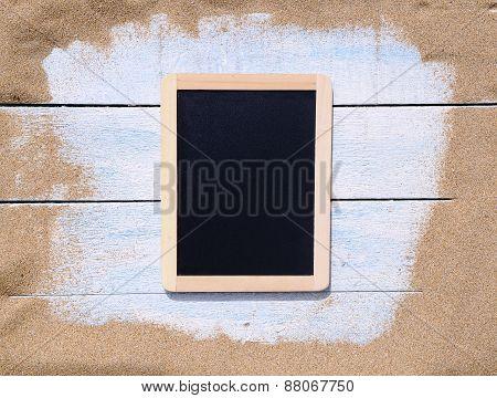 Blackboard On Beach.
