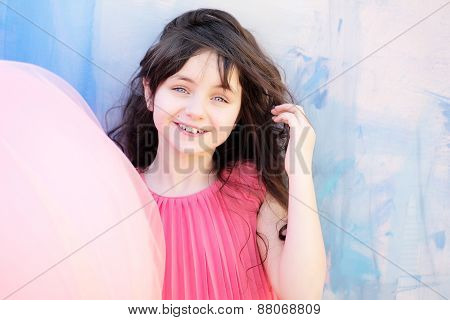 Pretty Little Girl Smiling On Bright Background