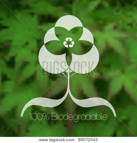 Eco friendly tree design against blurred green leafy background.