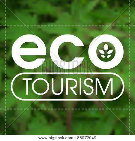 Ecotourism label against blurred green leafy background.