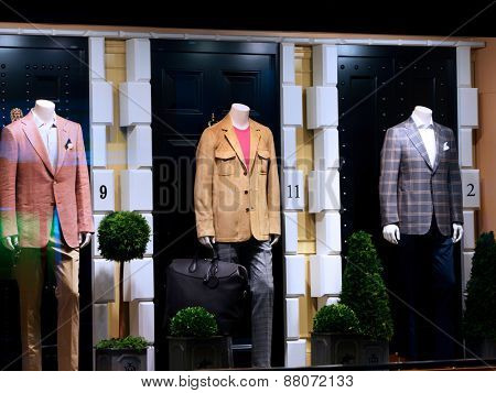Fashion shop display window with mannequins