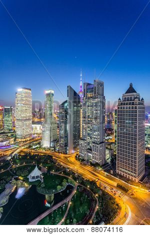 skyline,illuminated skyscrapers in modern city at night.