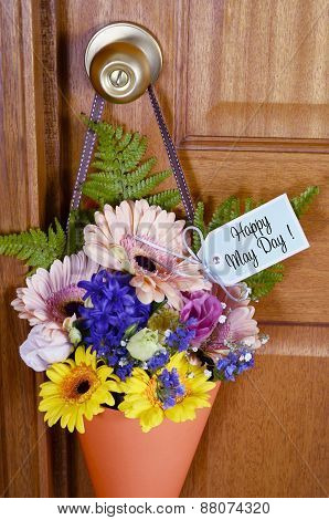 Happy May Day Gift Of Flowers On Door.
