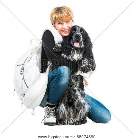 young pretty woman with her dog cocker spaniel in a studio isolated on a white background