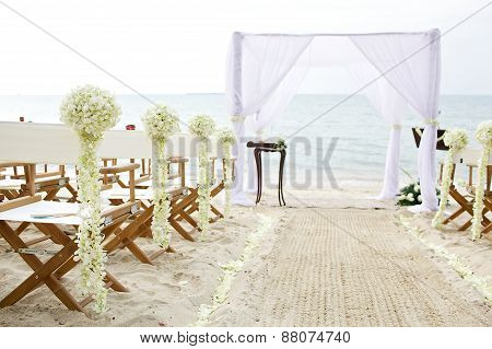 white theme wedding setup on the beach