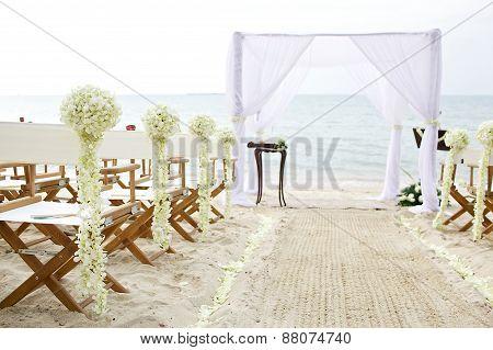white theme wedding setup on the beach