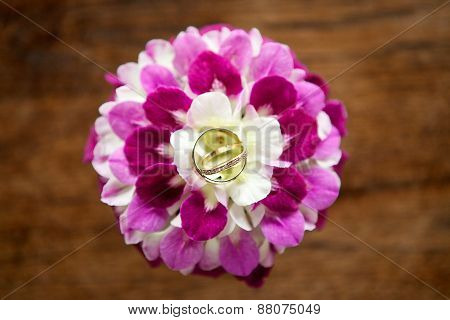 rings-wedding engagement anniversary ringss on pink and white flower ring holder