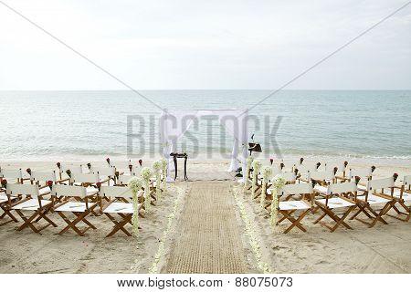 White theme beach wedding setup