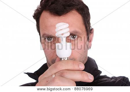 businessman holding a lamp