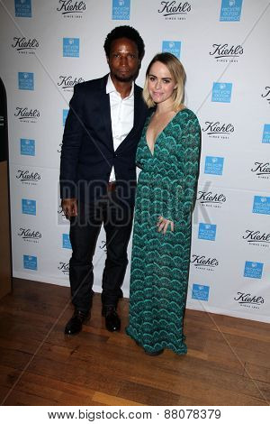 LOS ANGELES - FEB 15:  Elvis Nolasco, Taryn Manning at the Kiehls Earth Day Creamy Eye Treatment at the Kiehls on April 15, 2015 in Santa Monica, CA