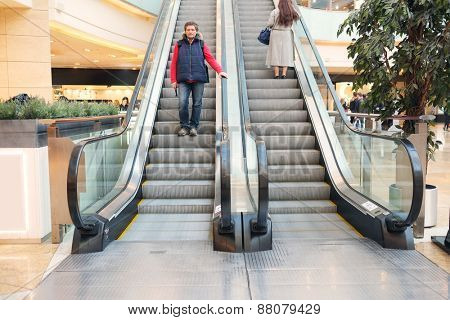 The man on the escalator at the mall