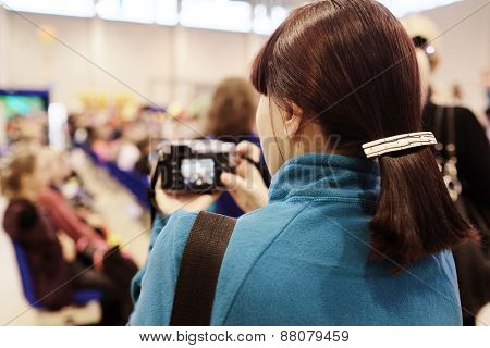Woman photographer in the conference room