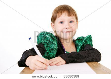 little girl in beautiful green dress with pen in hand on white background