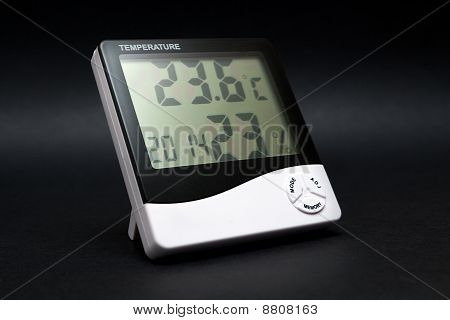 Black And White Thermometer On Black Background.