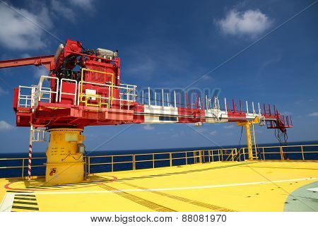 Crane construction on Oil and Rig platform for support heavy cargo, Transfer cargo or basket on work