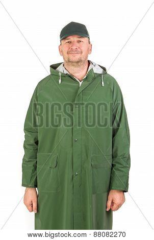 Man in rain green long coat.