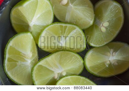 Fresh Cut Limes In A Bowl