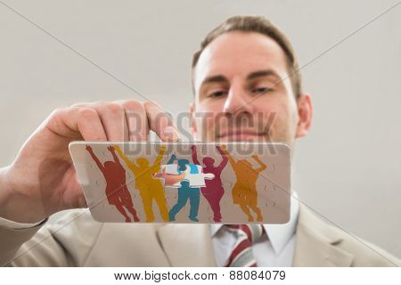 Businessman Making Human Figure