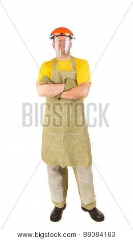Smiling welder in apron.