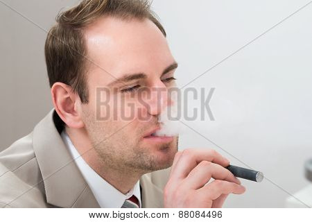 Businessman Smoking Electronic Cigarette