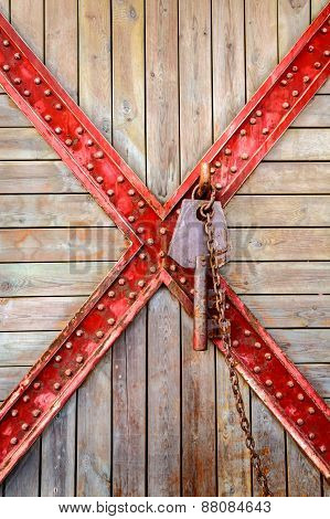 Old Wooden And Cross Metal With Rusty Key