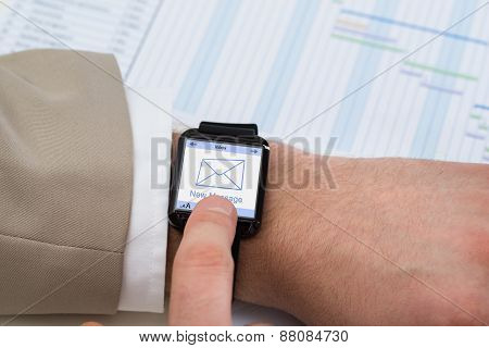 Hand With Smartwatch Showing Unread Message