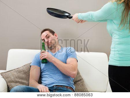 Wife Hitting Husband With Pan