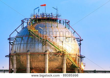 Natural Petrochemical Gas Storage Tank In Heavy Petroleum Industry Estate Against Clear Blue Sky Bac